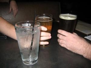 Drinking water at bar